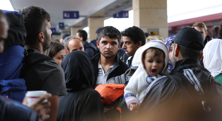 Syrian refugees waiting for a train